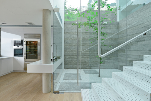 Stairway Courtyard Brings a Glass Box of Light into Hong Kong Renovation
